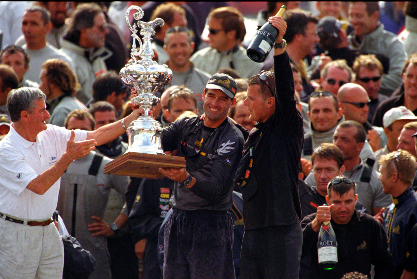Russel Coutts and Dean Barker from Team New Zealand holding the America's cup in 2000 by Franck Socha