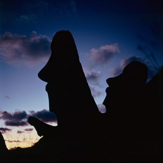 Moais at sunset on Easter Island by Franck Socha