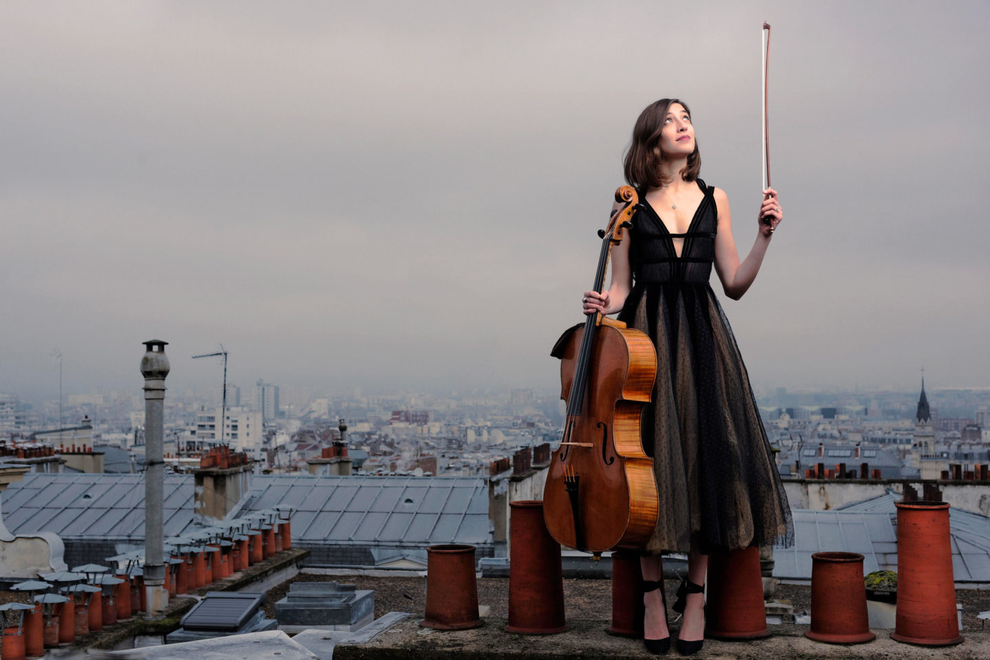 Camille Thomas the cello player on roof like Mary Poppin's by Franck Socha